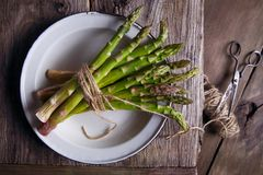 Fresh asparagus in a bowl. On the table Stock Photo