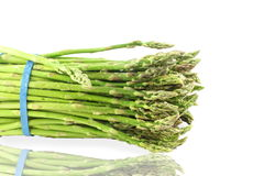 Fresh asparagus bunch in pure white background Royalty Free Stock Photos