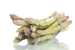 Fresh asparagus. Bunch of fresh asparagus on a white reflective background Royalty Free Stock Photo