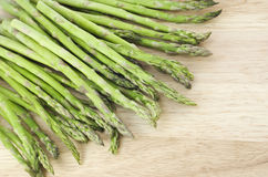 Fresh Asparagus on Cutting Board Stock Images