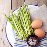 Fresh asparagus, olive oil and eggs . Stock Photography