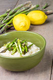 Fresh asparagus risotto with lemons Royalty Free Stock Photography