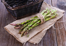 Fresh asparagus on a rustic wooden background. Bunch of fresh asparagus on a rustic wooden background royalty free stock photos