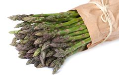 Fresh asparagus shoots in paper packing isolated Stock Photography