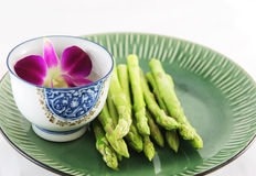 Fresh asparagus shoots on a plate Stock Image
