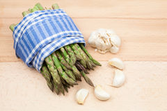 Fresh asparagus stems and garlic Royalty Free Stock Image
