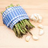Fresh asparagus stems and garlic Royalty Free Stock Photos