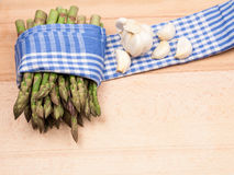 Fresh asparagus stems and garlic Stock Photography