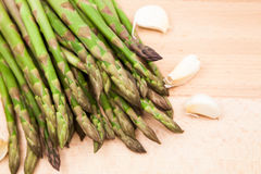 Fresh asparagus stems and garlic Stock Image