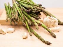 Fresh asparagus stems and garlic Royalty Free Stock Photos
