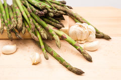 Fresh asparagus stems and garlic Royalty Free Stock Images