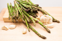 Fresh asparagus stems and garlic Stock Images