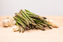 Fresh asparagus stems and garlic Stock Image
