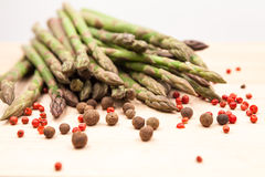 Fresh asparagus stems with spices Royalty Free Stock Photo