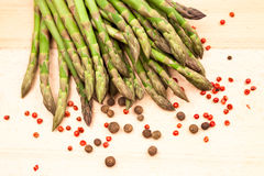 Fresh asparagus stems with spices Royalty Free Stock Photos