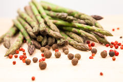 Fresh asparagus stems with spices Stock Image