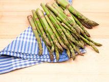 Fresh asparagus stems in a textile napkin Royalty Free Stock Photos