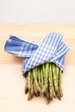 Fresh asparagus stems in a textile napkin Stock Photography