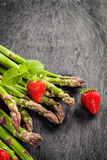 Fresh asparagus, strawberries and peppermint Royalty Free Stock Image