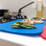 Fresh asparagus tips and mushrooms on a board Stock Image