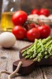 Fresh asparagus, tomatoes, eggs Royalty Free Stock Image