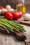 Fresh asparagus, tomatoes, eggs Royalty Free Stock Photos