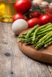 Fresh asparagus, tomatoes, eggs Royalty Free Stock Images