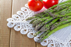 Fresh asparagus with vegetables. On a wooden background Stock Images