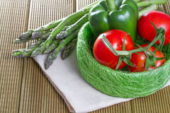 Fresh asparagus with vegetables. On a wooden background Royalty Free Stock Photos