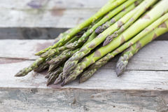 Fresh asparagus on wood surface Stock Images