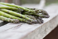Fresh asparagus on wood surface Royalty Free Stock Photography