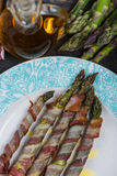 Fresh asparagus wrapped in crispy bacon or pancetta Royalty Free Stock Photography