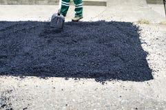 Fresh asphalt on the old road Stock Image