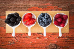 Fresh assorted berries on a grungy wooden counter Stock Photo