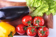 Fresh assorted vegetables, eggplant, bell pepper, tomato, garlic with leaf lettuce.  on white background