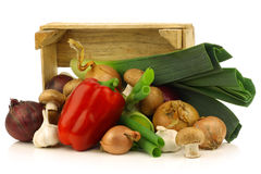 Fresh assorted vegetables in a wooden crate Royalty Free Stock Images