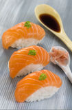 Fresh  atlantic salmon Sushi with dressing. Fresh  Atlantic salmon Sushi with soy sauce Stock Images