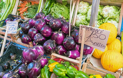 Fresh aubergines and salad at a market Stock Photos