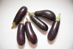 Fresh aubergines on white Stock Photography