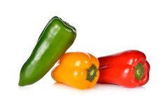Fresh Aura sweet red, green and yellow pepper on white Royalty Free Stock Image