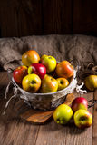 Fresh autumn apples in the basket Royalty Free Stock Photos