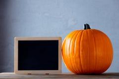 Fresh Autumn pumpkin and blackboard menu Stock Photo