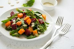 Free Fresh Autumn Salad With Marinated Pumpkin And Beetroot, Spinach Leaves,olive Oil, Sesame And Pumpkin Seeds Royalty Free Stock Image - 107071156