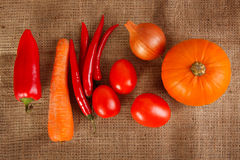 Fresh autumn vegetables lie on sacking Royalty Free Stock Images