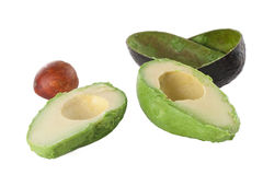 Fresh Avocado. Avocado halves with the skin and pit in the background Royalty Free Stock Photos