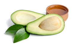 Fresh avocado with avocado oil in the wooden bowl Royalty Free Stock Image