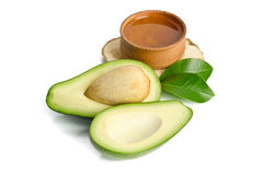 Fresh avocado with avocado oil in the wooden bowl Royalty Free Stock Images