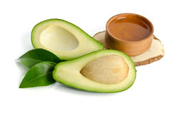 Fresh avocado with avocado oil in the wooden bowl Stock Photos