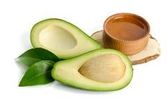 Fresh avocado with avocado oil in the wooden bowl Stock Photos