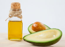 Fresh avocado and a bottle of oil Royalty Free Stock Images